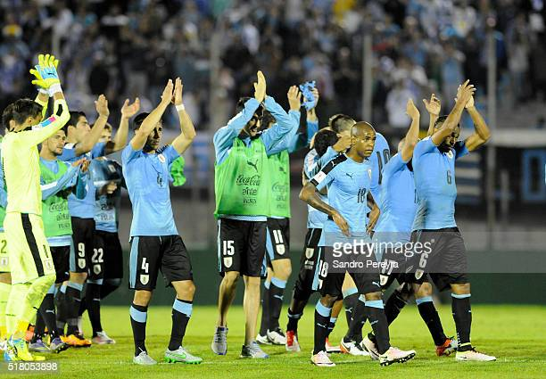 Players of Uruguay celebrate after winning a match between Uruguay and Peru as part of FIFA 2018 World Cup Qualifiers at Centenario Stadium on March...