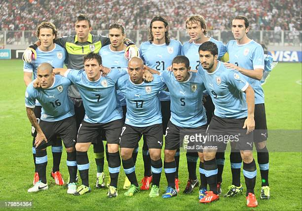 Players of Uruguay pose for a group photo prior to a match between Peru and Uruguay as part of the 15th round of the South American Qualifiers at...