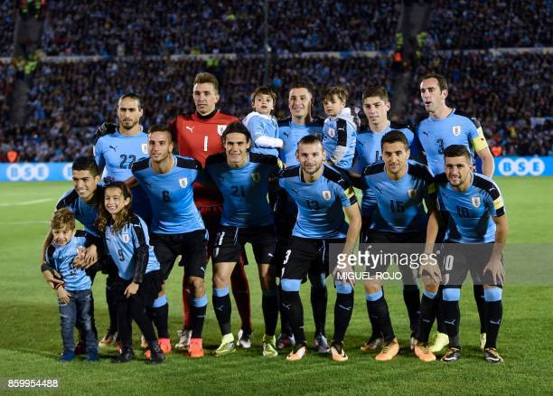 Players of Uruguay pose for pictures before the start of their 2018 World Cup football qualifier match against Bolivia in Montevideo on October 10...