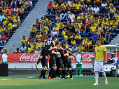 Players of US celebrate after scoring the opening goal during a U23 Olympic Qualifying Playoff match between Colombia and USA at Metropolitano...