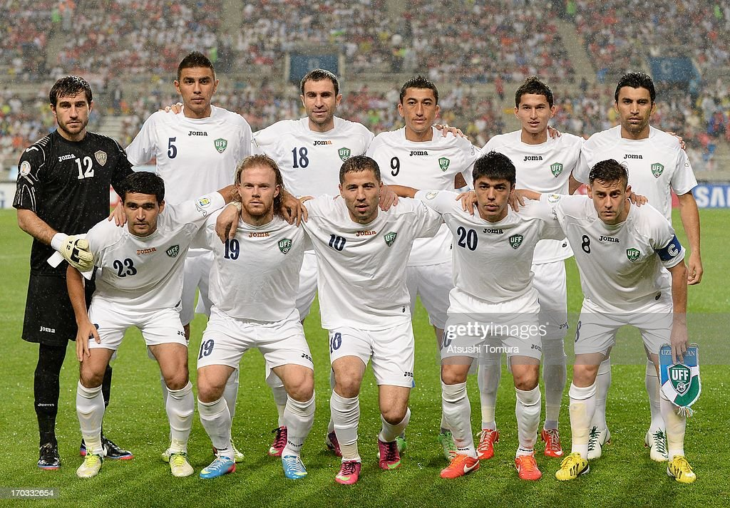 Players of Uzbekistan line up for a group photograph during the FIFA World Cup qualifier match between South Korea and Uzbekistan at Seoul World Cup...