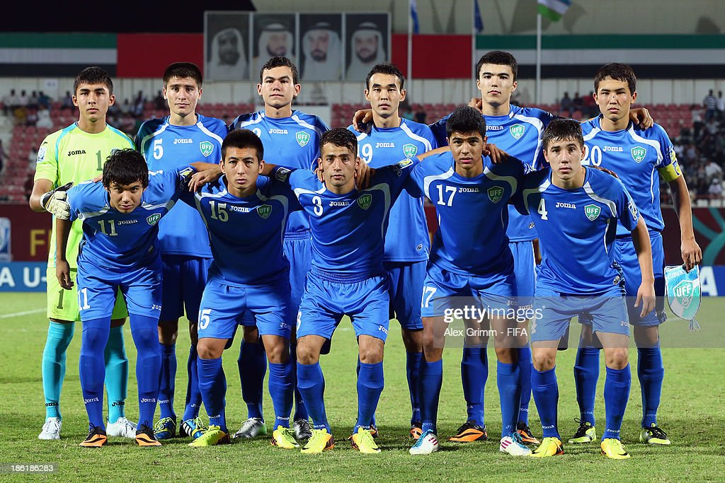 Players of Uzbekistan pose for a team photo prior to the FIFA U-17 World Cup UAE 2013 Round of 16 match between Honduras and Uzbekistan at Sharjah Stadium on October 28, 2013 in Sharjah, United Arab Emirates.