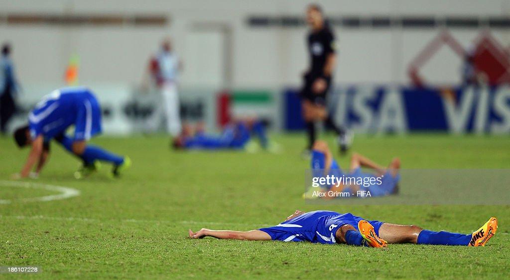 Players of Uzbekistan react after the FIFA U-17 World Cup UAE 2013 Round of 16 match between Honduras and Uzbekistan at Sharjah Stadium on October 28, 2013 in Sharjah, United Arab Emirates.
