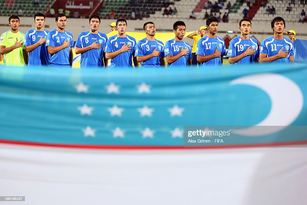 Players of Uzbekistan sing their national anthem prior to the FIFA U-17 World Cup UAE 2013 Round of 16 match between Honduras and Uzbekistan at Sharjah Stadium on October 28, 2013 in Sharjah, United Arab Emirates.