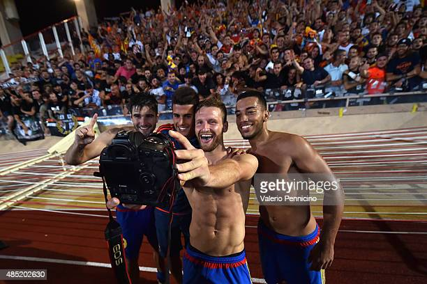 Players of Valencia pose for a selfie at the end of the UEFA Champions League qualifying round play off second leg match between Monaco and Valencia...