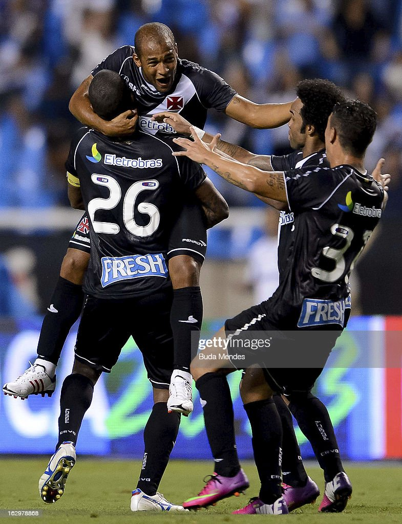 Players of Vasco celebrate a scored goal against Fluminense during the match between Fluminense and Vasco as part of Carioca Championship 2013 at...