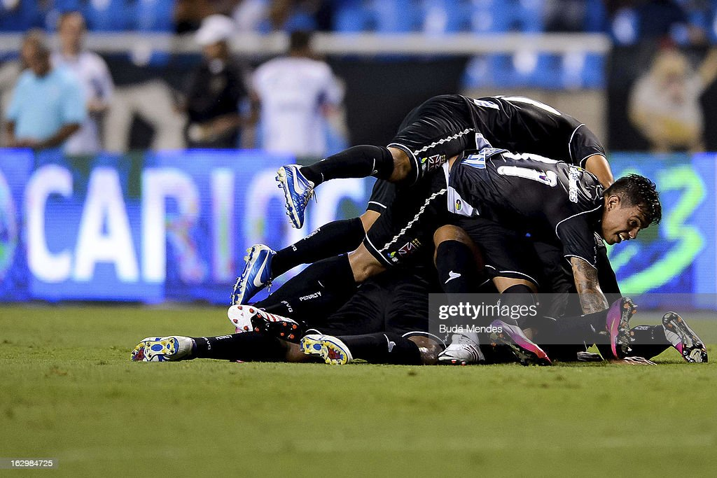 Players of Vasco celebrate ascored goal against Fluminense during the match between Fluminense and Vasco as part of Carioca Championship 2013 at...