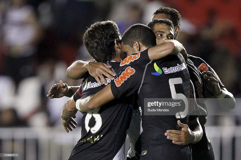 Players of Vasco celebrate scored goal aganist Palmeiras during a match as part of Copa Bridgestone Sudamericana 2011 at Sao Januario stadium on...