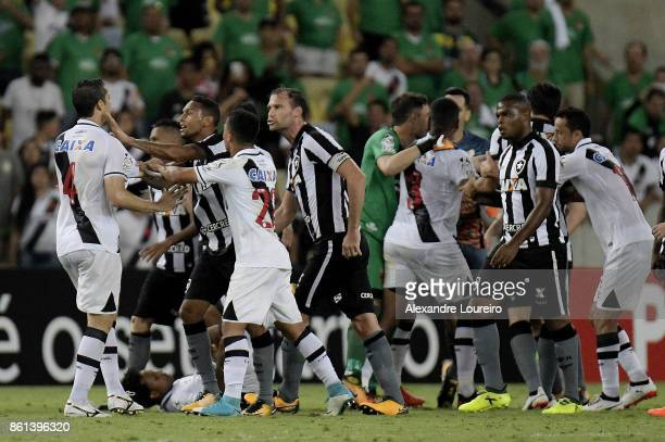 Players of Vasco da Gama and Botafogo fight each other during the match between Vasco da Gama and Botafogo as part of Brasileirao Series A 2017 at...
