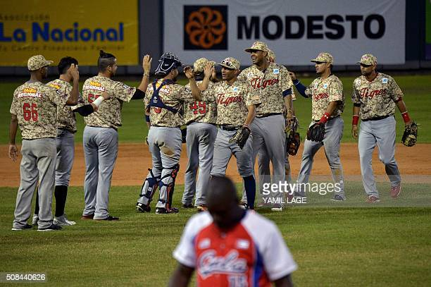 Players of Venezuela celebrate after defeating Cuba in their 2016 Caribbean Baseball Series game in Santo Domingo Dominican Republic on February 4...