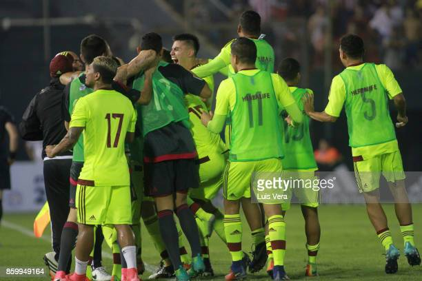 Players of Venezuela celebrate after teammate Yangel Herrera scored the first goal of his team during a match between Paraguay and Venezuela as part...