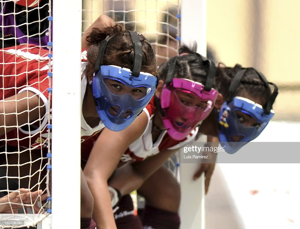 Players of Venezuela in action during the Women's hockey match between Republica Dominicana and Venezuela as part of the XVII Bolivarian Games Trujillo 2013 at Colegio San Jose on November 27, 2013 in Chiclayo, Peru.