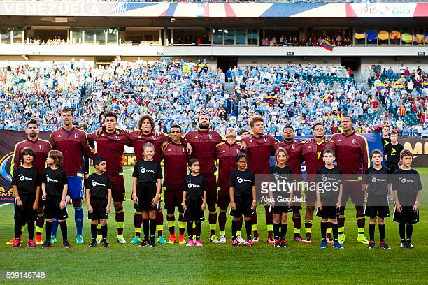 Players of Venezuela line up during the Venezuela National Anthem before a group C match between Uruguay and Venezuela at Lincoln Financial Field as...