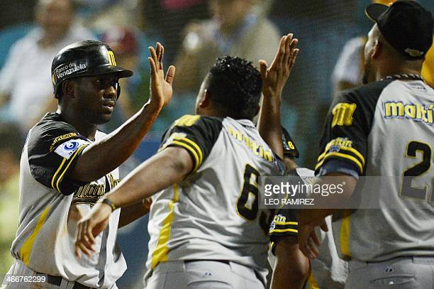 Players of Venezuela's Navegantes del Magallanes celebrate after scoring against Mexico's Naranjeros de Hermosillo during their 2014 Caribbean...
