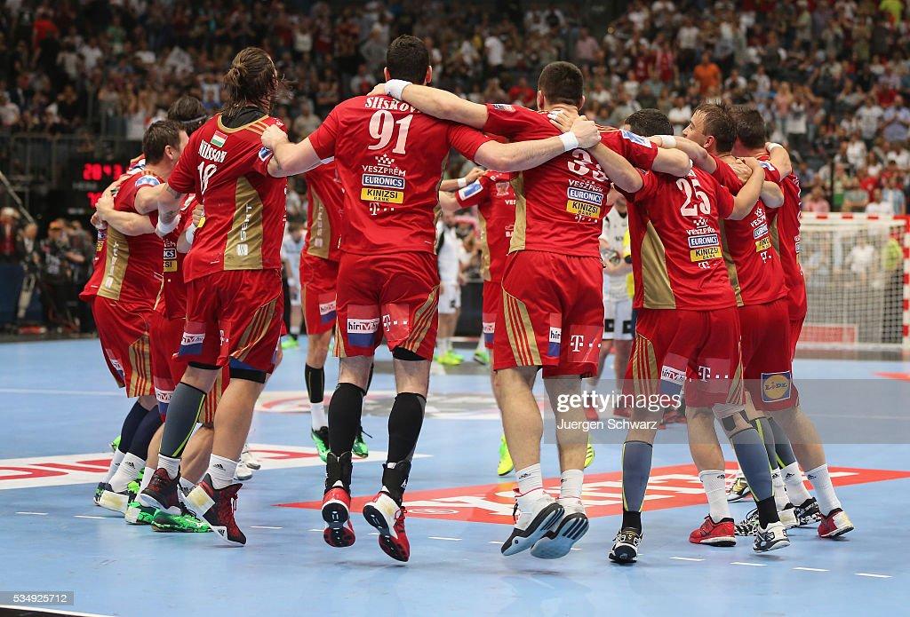 Players of Veszprem celebrate after winning the second semi-final of the EHF Final4 between THW Kiel and MVM Veszprem on May 28, 2016 in Cologne, Germany.