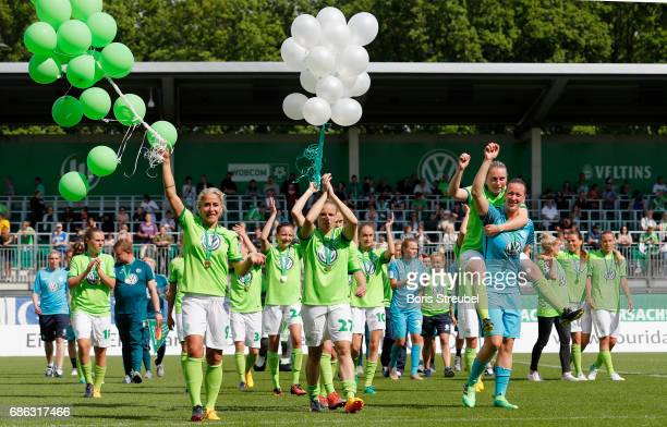Players of VfL Wolfsburg wave to their fans in celebration of the German Championship title following the Allianz Women's Bundesliga match between...