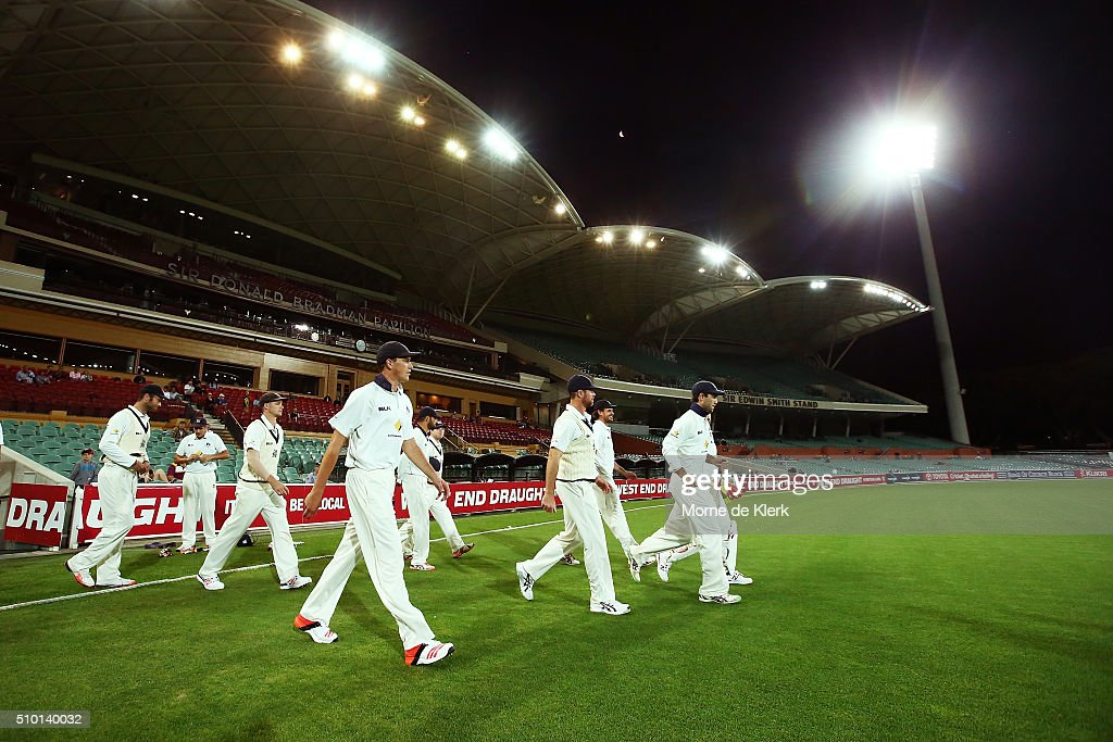 Players of Victoria walk onto the field during day one of the Sheffield Shield match between South Australia and Victoria at Adelaide Oval on February 14, 2016 in Adelaide, Australia.