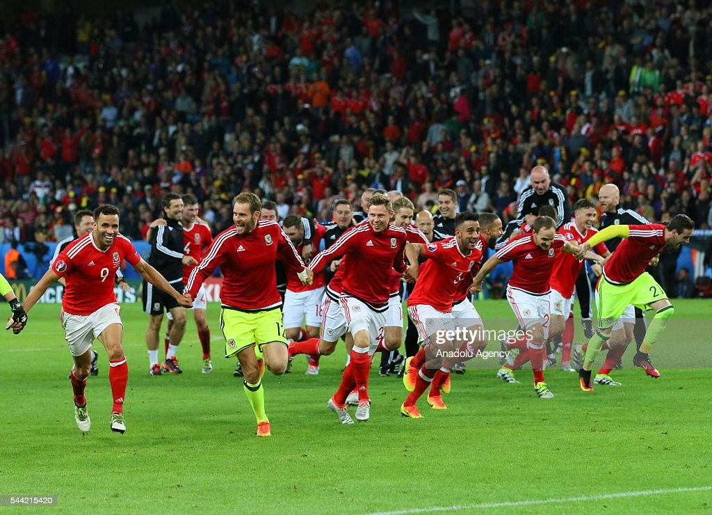 Players of Wales celebrate the victory following the UEFA Euro 2016 quarter final match between Wales and Belgium at Stade Pierre-Mauroy on July 1, 2016 in Lille, France.