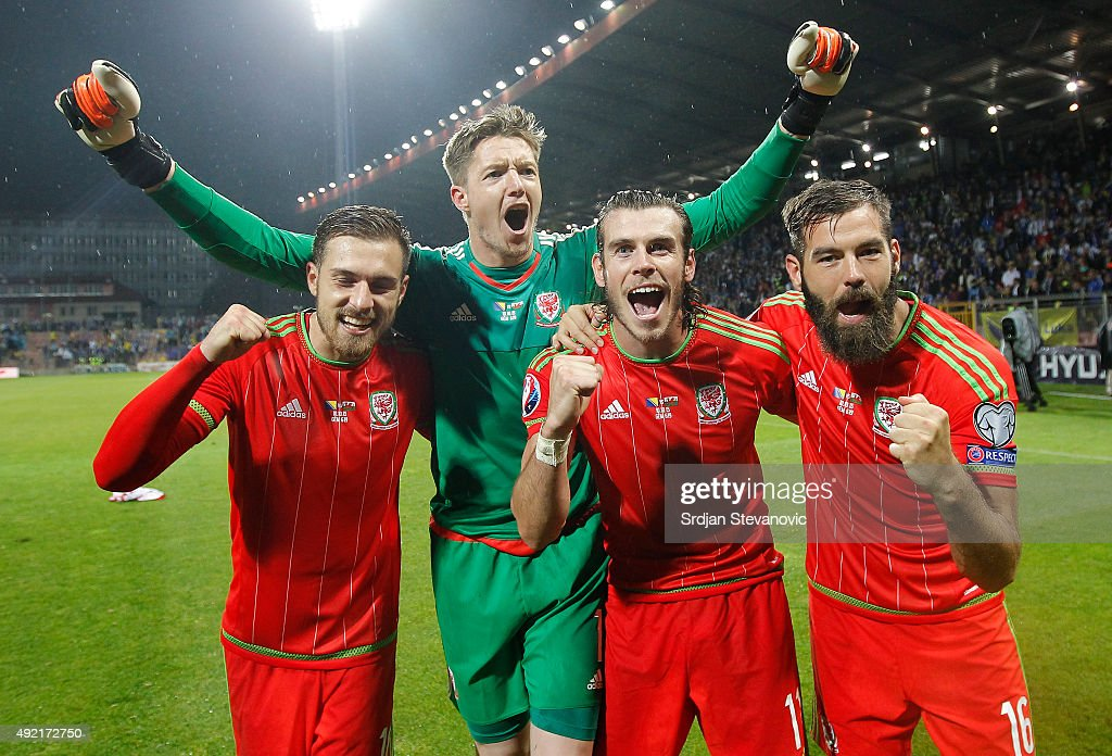 Players of Wales national team Aaron Ramsey goalkeeper Wayne Hennesey Gareth Bale and Joe Ledley celebrate the Euro 2016 qualifying football match...