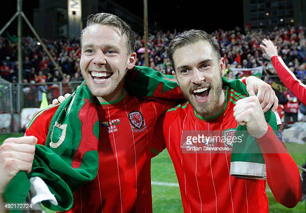 Players of Wales national team Chris Gunter and Aaron Ramsey celebrate the Euro 2016 qualifying football match between Bosnia and Herzegovina and...