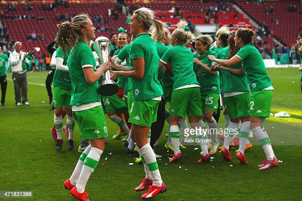 Players of Wolfsburg celebrate with the trophy after winning the Women's DFB Cup Final between Turbine Potsdam and VfL Wolfsburg at...