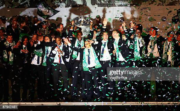 Players of Wolfsburg celebrate with the trophy during the public welcome ceremony in the city of Wolfsburg to celebrate winning of the German...