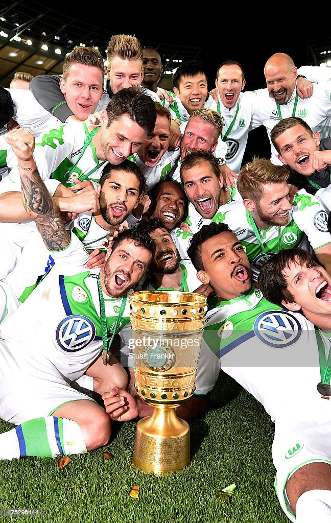 Players of Wolfsburg celebrate with the trophy following the DFB Cup Final match between Borussia Dortmund and VfL Wolfsburg at Olympiastadion on May 30, 2015 in Berlin, Germany.