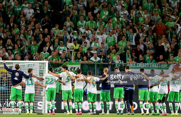 Players of Wolfsburg celebrate with their fans after winning the Bundesliga match between VfL Wolfsburg and FC Schalke 04 at Volkswagen Arena on...