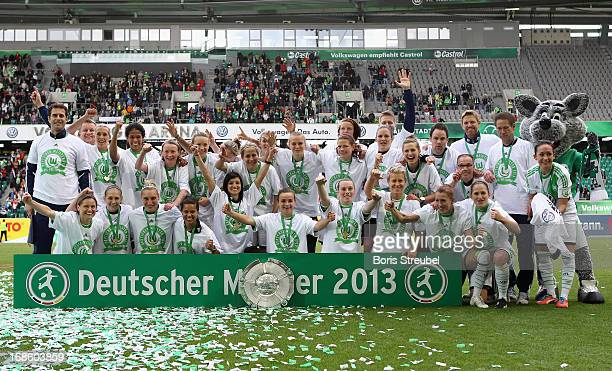Players of Wolfsburg pose for a teamphoto with the trophy after winning the German championship after the Women's Bundesliga match between VfL...