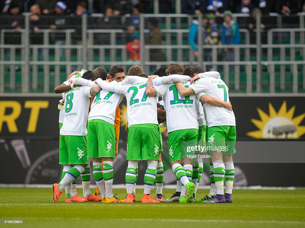 Players of Wolfsburg stand together during the Bundesliga match between VfL Wolfsburg and Hertha BSC Berlin at Volkswagen Arena on March 19, 2016 in Wolfsburg, Germany.