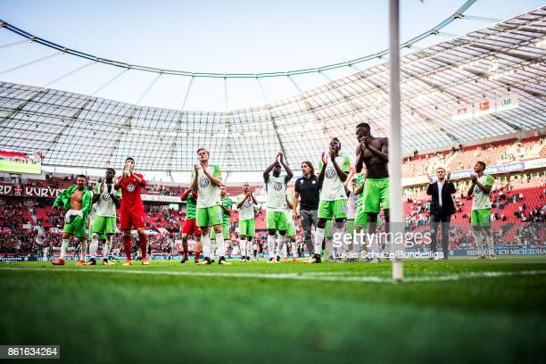 Players of Wolfsburg thanks for the support during the Bundesliga match between Bayer 04 Leverkusen and VfL Wolfsburg at BayArena on October 15 2017...