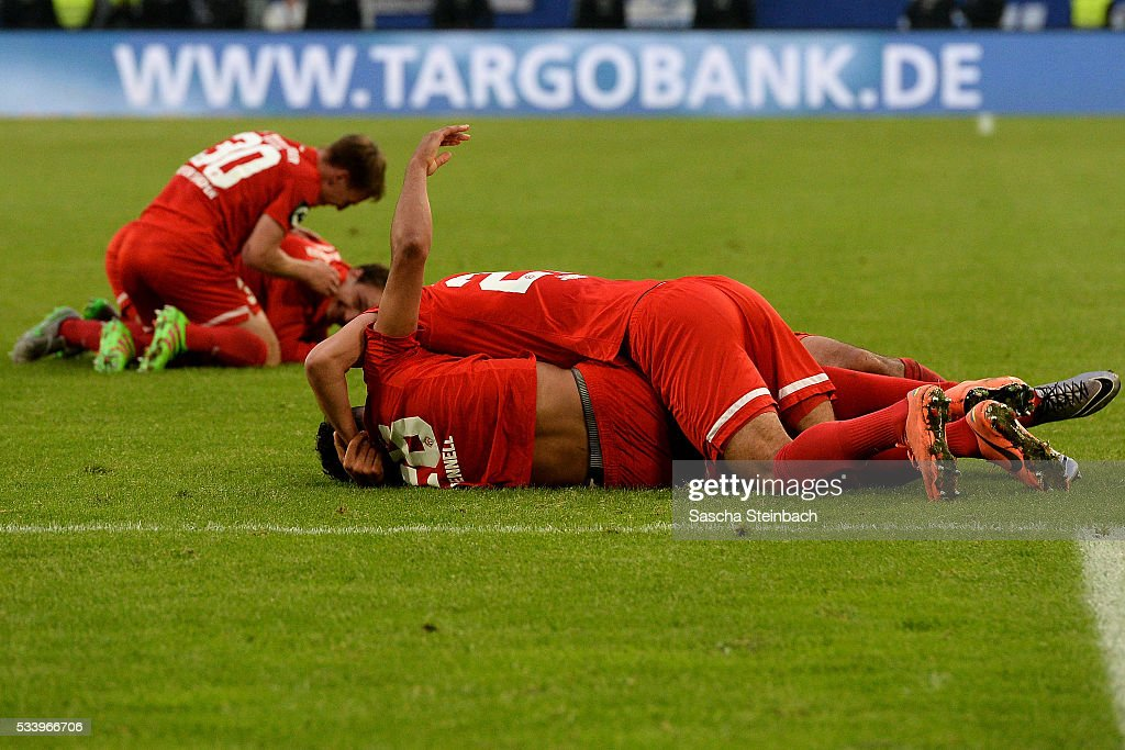 Players of Wuerzburg celebrate after winning the 2. Bundesliga playoff leg 2 match against MSV Duisburg at Schauinsland-Reisen-Arena on May 24, 2016 in Duisburg, Germany.