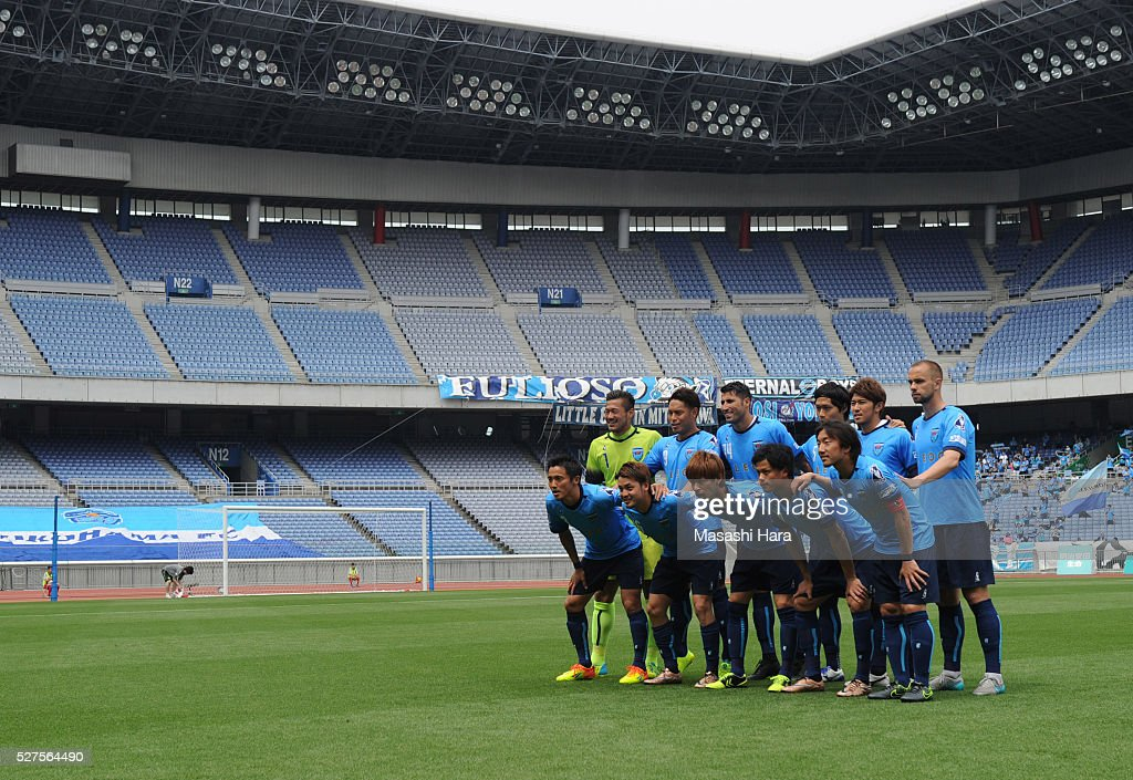 Players of Yokohama FC pose for photograph with many empty seats prior to the J.League second division match between Yokohama FC and Fagiano Okayama at the Nissan Stadium on May 3, 2016 in Yokohama, Kanagawa, Japan.