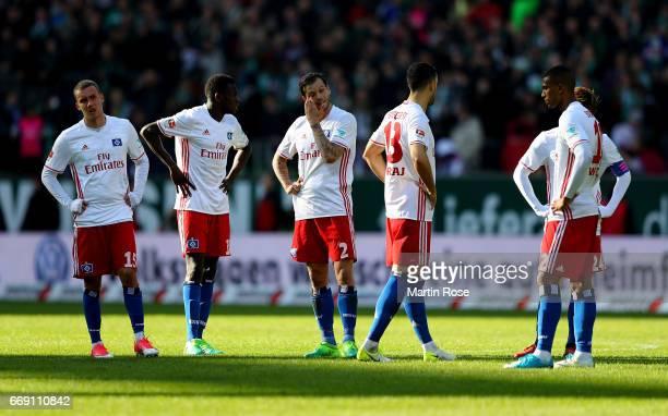Players off Hamburg look dejected after the Bundesliga match between Werder Bremen and Hamburger SV at Weserstadion on April 16 2017 in Bremen Germany