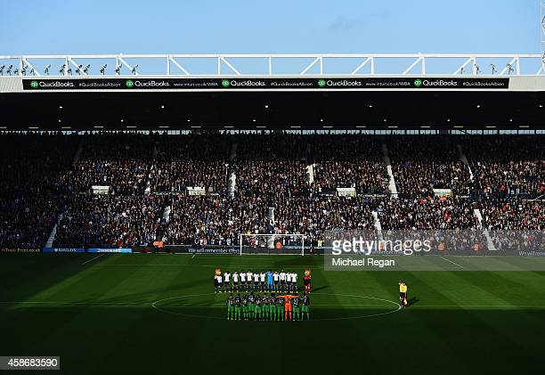 Players officials and fans observe a Remembrance Day silence prior to the Barclays Premier League match between West Bromwich Albion and Newcastle...