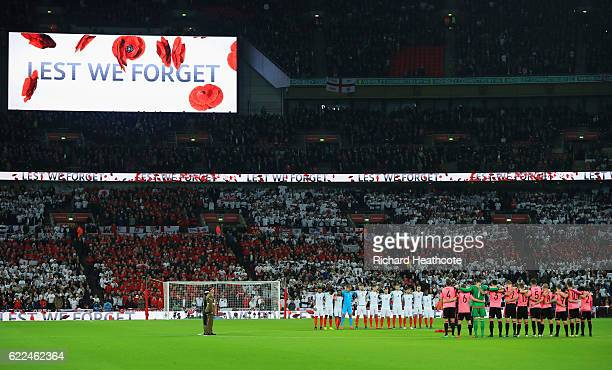 Players officials and fans observe a silence in remembrance of Armistice Day prior to the FIFA 2018 World Cup qualifying match between England and...