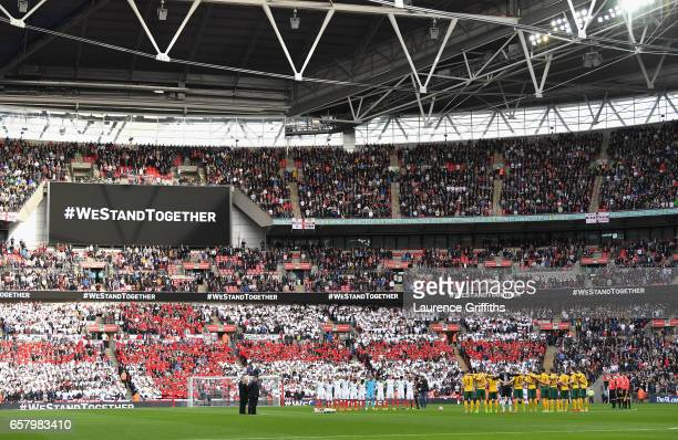 Players officials fans and dignitaries remember those who lost their lives in the recent Westminster terrorist attacks prior to the FIFA 2018 World...