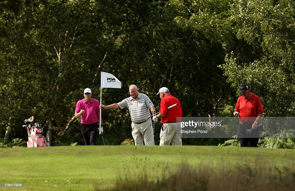 Players on a green during the PGA Super 60's Tournament at Thorpeness Hotel and Golf Club on August 30, 2013 in Thorpeness, England.