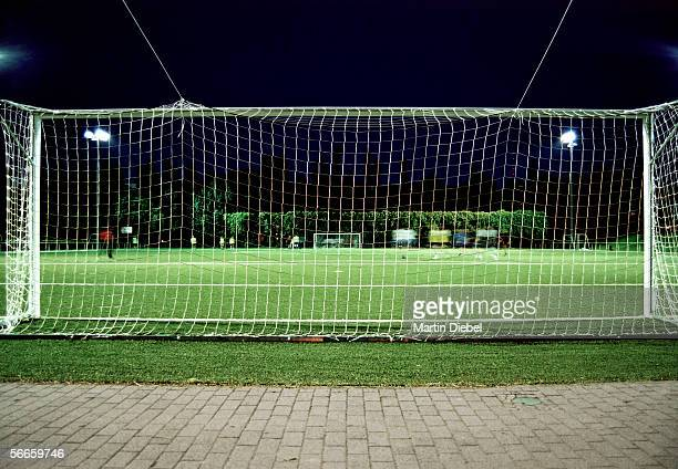 Players on a soccer field at night