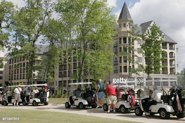 Players on electric carts at Renaissance Ross Bridge Golf Resort and Spa