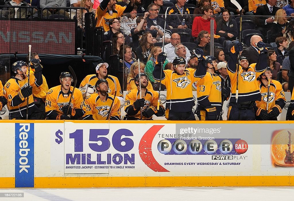 Players on the bench of the Nashville Predators react after a goal against the Florida Panthers at Bridgestone Arena on October 15, 2013 in Nashville, Tennessee.