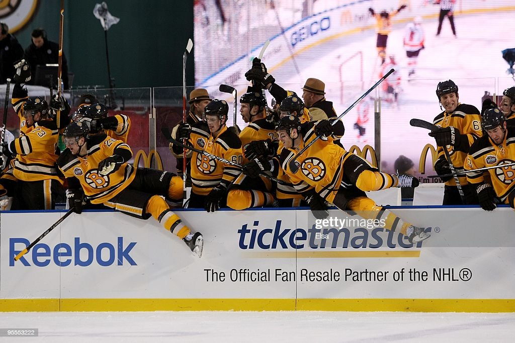 Players on the Boston Bruins leave the bench to celebrate their 21 overtime victory over the Philadelphia Flyers during the 2010 Bridgestone Winter...
