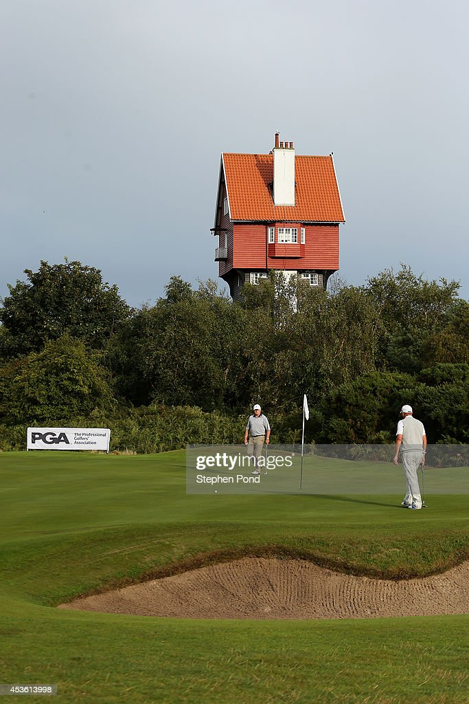 Players on the eighteenth green during day one of the PGA Super 60's Tournament at Thorpeness Hotel and Golf Club on August 14, 2014 in Thorpeness, England.