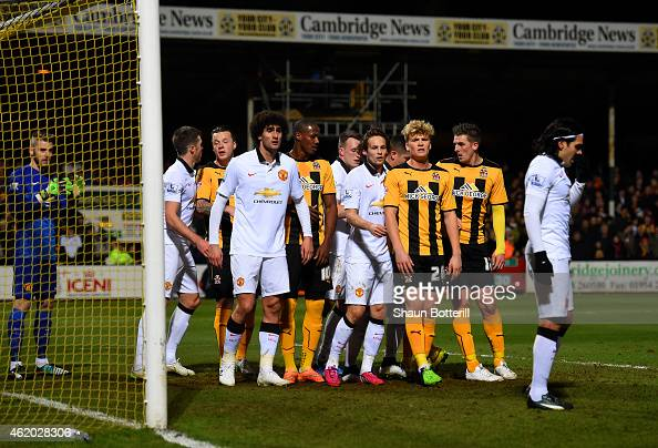 Players pack the sixyard box as Cambridge prepare to take a corner during the FA Cup Fourth Round match between Cambridge United and Manchester...