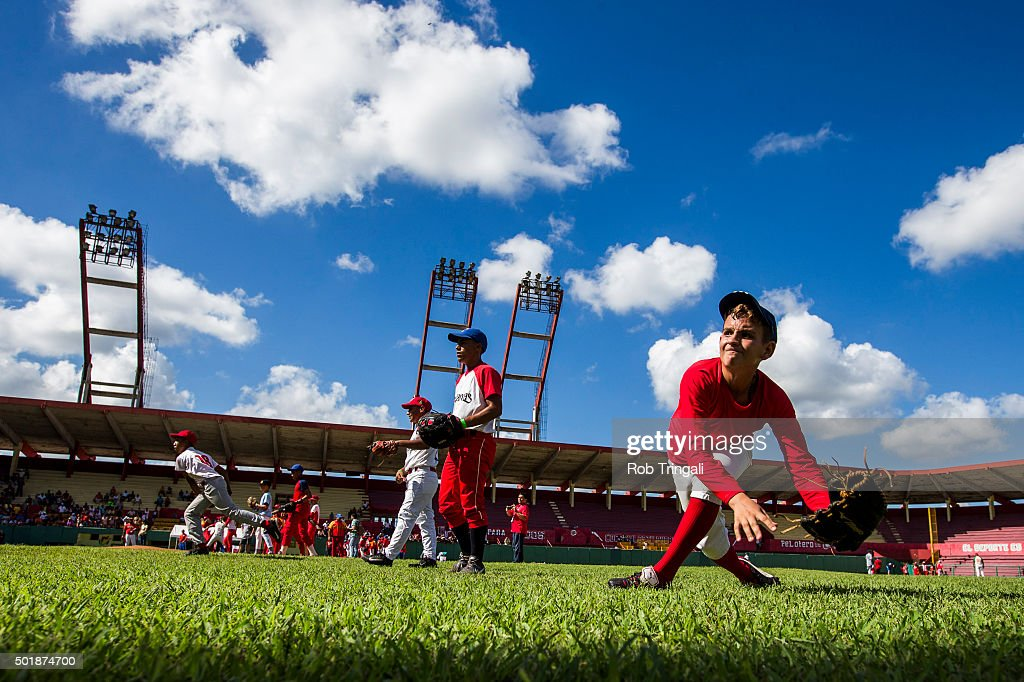 Players participate in a youth baseball clinic during an MLB goodwill tour on December 17, 2015 at Estadio Victoria de Giron in Matanzas, Cuba.