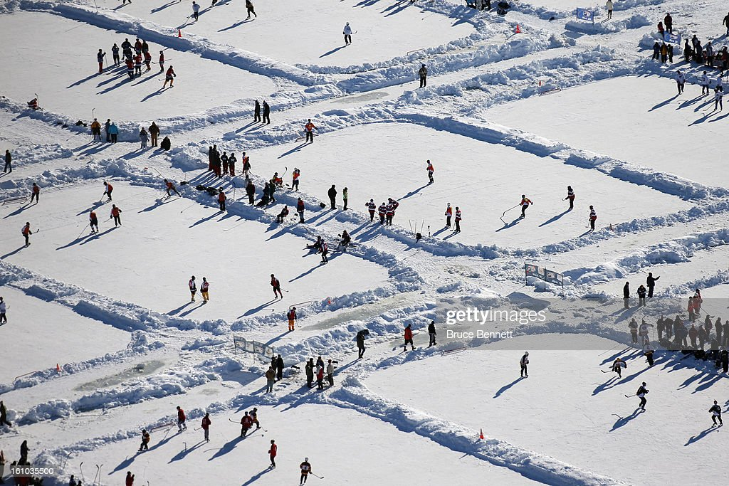 Players participate in the 2013 USA Hockey Pond Hockey National Championships on February 8, 2013 in Eagle River, Wisconsin. The three-day tournament features 2,400 participants from 30 states playing a round robin tournament on 28 rinks laid out on Dollar Lake.