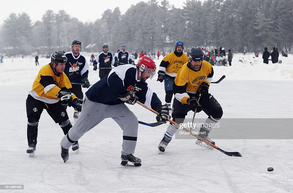 Players participate in the 2013 USA Hockey Pond Hockey National Championships on February 10, 2013 in Eagle River, Wisconsin. The three day tournament features 2,400 participants from 30 states playing a round robin tournament on 28 rinks laid out on Dollar Lake.
