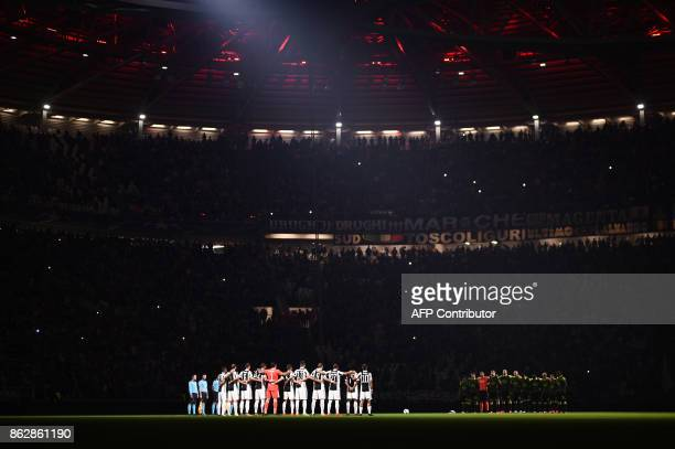 Players pay tribute to the victims of fires in Portugal before the UEFA Champions League Group D football match Juventus vs Sporting CP at the...
