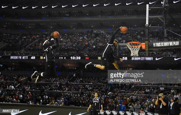 TOPSHOT Players perform at halftime in the NBA game between the Oklahoma City Thunder and Brooklyn Nets on December 7 in Mexico City / AFP PHOTO /...