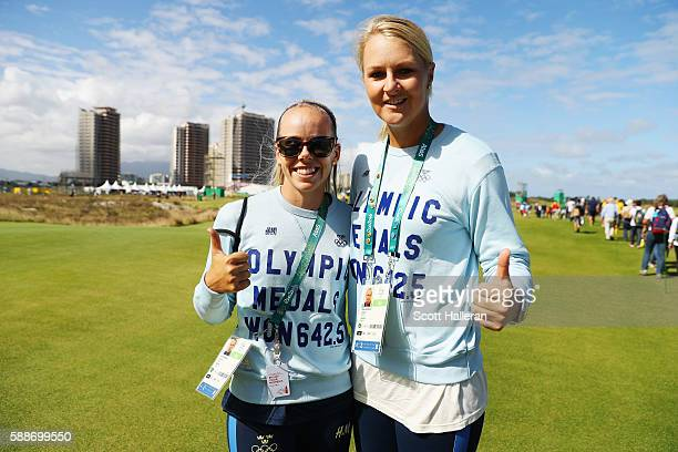 LPGA players Pernilla Lindberg and Anna Nordqvist follow the play of Henrik Stenson during the second round of the golf on Day 7 of the Rio 2016...